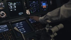 Pilot sets the course inside the airplane cockpit. Pilot pushing buttons while sets the course in airplane cockpit stock video