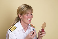 Pilot putting on make up Royalty Free Stock Photography
