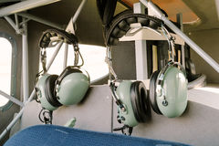 Pilot radio headphones. Within an ultralight aircraft cabin Royalty Free Stock Images
