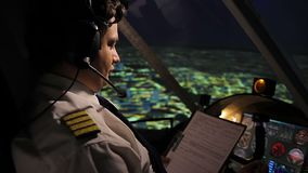 Pilot reading and filling out flight form, navigating plane in autopilot mode stock video