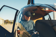 Pilot reading map in a helicopter cockpit Royalty Free Stock Images