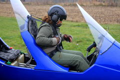 Pilot ready for takeoff with gyrocopter. Female pilot ready for takeoff with gyrocopter stock photos