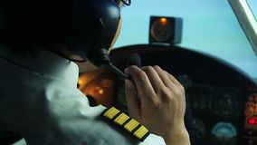 Pilot receives a message from dispatcher, continues flight, air transportation. Stock footage stock footage