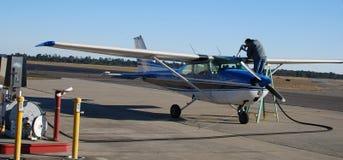 Pilot refueling small airplane Stock Photo