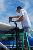 Pilot refueling small airplane Stock Photography