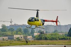 Pilot of Robinson R44 Raven on airshow. Tyumen, Russia - August 11, 2012: On a visit at UTair airshow in heliport Plehanovo. Pilot of Robinson R44 Raven shows Stock Photo