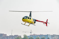 Pilot of Robinson R44 Raven over city Stock Photography