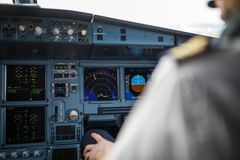 Pilot`s hand accelerating on the throttle in airplane flight cockpit during takeoff royalty free stock image
