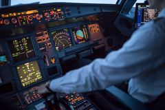 Pilot`s hand accelerating on the throttle in a commercial airliner stock photos