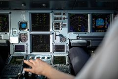 Pilot`s hand accelerating on the throttle in airplane flight cockpit during takeoff royalty free stock photography