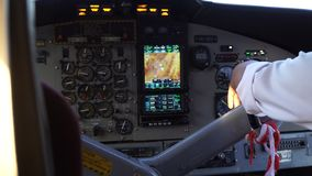 The pilot`s hand on the helm of the aircraft. Cockpit inside. The pilot`s hand on the helm of the aircraft. The plane is preparing to take off stock footage