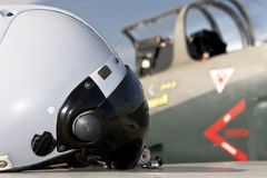 Pilot's helmet and jet aircraft Royalty Free Stock Photo