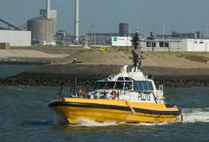 A pilot ship in the harbor Stock Image