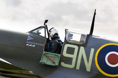 Pilot sits in cockpit of Supermarine Spitfire british fighter aircraft Royalty Free Stock Photos