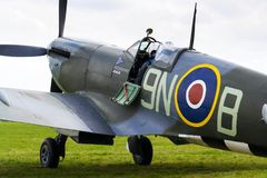 Pilot sits in cockpit of Supermarine Spitfire british fighter aircraft Stock Photos