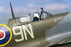 Free Pilot Sits In Cockpit Of Supermarine Spitfire British Fighter Aircraft Stock Photography - 102988642
