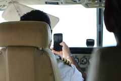 Pilot on a Smartphone. A pilot recording the spin of his propeller on a smartphone Royalty Free Stock Photography