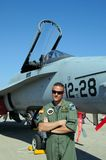 Pilot standing by F/A-18 Hornet. Stock Image