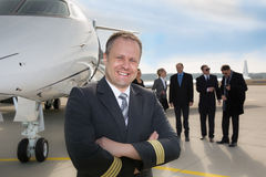 Pilot standing in front of corporate private jet Stock Image