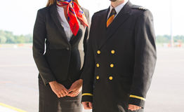 Pilot and stewardess. Royalty Free Stock Photos
