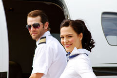 Pilot and stewardess entering plane Royalty Free Stock Photography