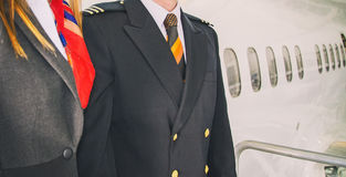 Pilot and stewardess. Stock Image
