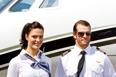 Pilot and stewardess by plane Royalty Free Stock Image