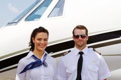 Pilot and stewardess ready for passengers Royalty Free Stock Images