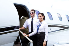 Pilot and stewardess stop before entering jet Royalty Free Stock Photography
