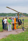 Pilot tells the spectators about his autogyro Stock Image