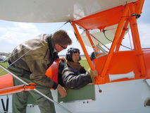 Pilot training in old biplane Stock Images