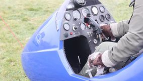 Pilot is trying to start a gyrocopter. Key contact stock video