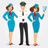 Pilot and two stewardesses in uniform Royalty Free Stock Photo