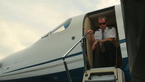 Pilot Unlatches Door and Exits Business Jet Airplane stock video footage