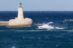 Pilot vessel entering back to harbor Royalty Free Stock Image