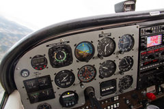 Pilot View of Complex Instrument Panel of Airplane. Various instruments and systems on airplane in flight Royalty Free Stock Photos