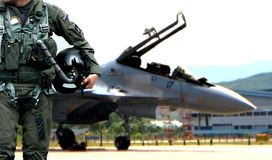 Pilot walking away from jet fighter Stock Photo