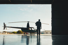 Pilot walking towards helicopter Royalty Free Stock Images