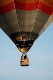 Pilot Works Gas Burners on Orange Grey Hot Air Balloon Stock Image