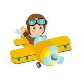Pilota sveglio Flies On del ragazzo un aeroplano tor Retro fondo di Isolated In White del pilota del ragazzo Pilota Costume del r Fotografia Stock