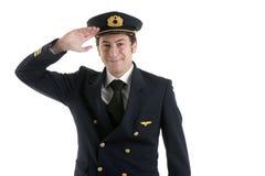 Pilote de compagnie aérienne/pilote Saluting Images stock