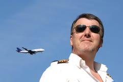 Pilote et avion à réaction Photographie stock libre de droits