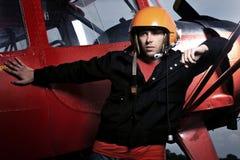Pilote sur le fond de ciel Photos libres de droits