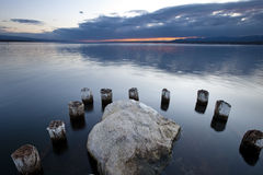 Pilotis e pietra del lago geneva Fotografia Stock