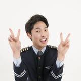Piloto asiático de sorriso da linha aérea Imagem de Stock