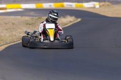 Piloto de Kart na trilha foto de stock