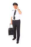 Piloto de la línea aérea con la carretilla fotografía de archivo