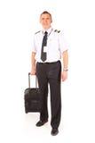 Piloto de la línea aérea con la carretilla Fotografía de archivo libre de regalías