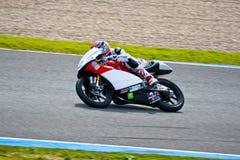 Piloto de Louis Rossi de 125cc en el MotoGP fotografía de archivo libre de regalías
