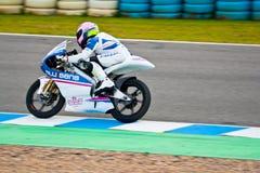 Piloto de Sergio Gadea de 125cc en el MOTOGP fotografía de archivo libre de regalías